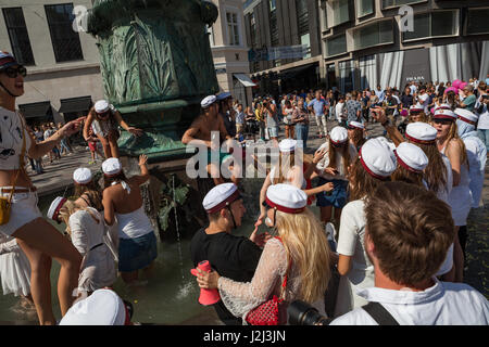COPENHAGEN, DENMARK - 26 JUN 2016: Students celebrate their high school graduation swimming and dancing in fountain - Stock Photo