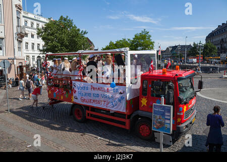 COPENHAGEN, DENMARK - 26 JUN 2016: Students celebrate their high school graduation in funny truck - Stock Photo