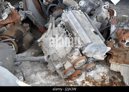 Old rusted engine ready for dismantling process - Stock Photo