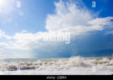 Dramatic sky over the English Channel near Hove coast - Stock Photo