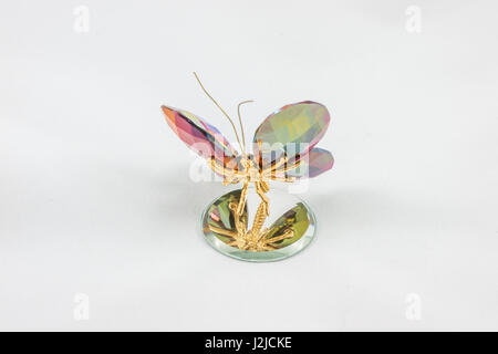 Figure Crystal Butterfly on a mirror with white background - Stock Photo