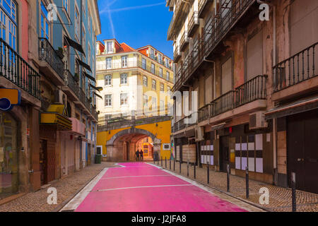 The famous Pink street in Lisbon, Portugal - Stock Photo