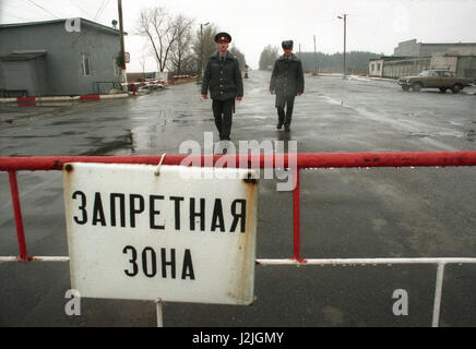 Ukraine. Chernobyl. A barrier with a sign 'Forbidden Zone'. - Stock Photo