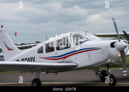 Piper PA-28-161 Warrior I on taxi way at North Weald Airfield - Stock Photo