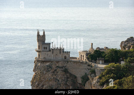 Close-up skyline of famous decorative building named Swallow's Nest known as one of symbols of Crimea in side light - Stock Photo