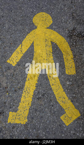 Pedestrian sign on the street in England. - Stock Photo