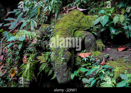 Statue of Komodo Dragon in the Monkey Forest of Ubud - Stock Photo