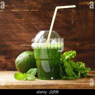 Fresh green organic smoothie from avocado - Stock Photo