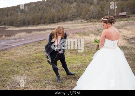Wedding Videographer with Bride - Stock Photo