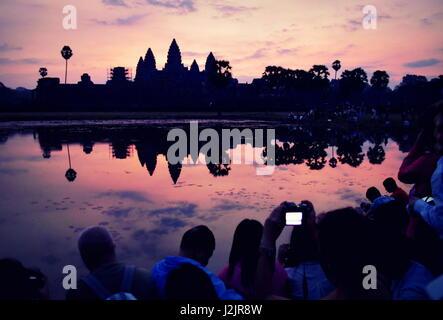 Beautiful sunrise colors over Angkor Wat ancient stone temple ruins, Cambodia - Stock Photo