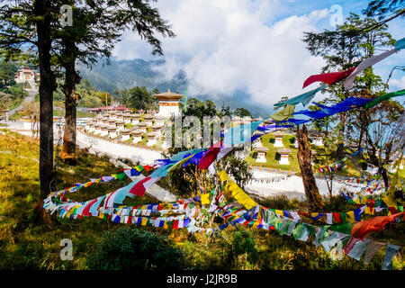 Dochula Pass one of Bhutan's high passes with a 108 memorial stupas or chortens built in the centre of the highway - Stock Photo