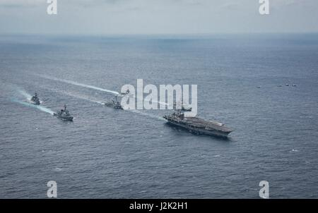 Philippine Sea. 28th April, 2017. The U.S. Navy Nimitz-class aircraft carrier USS Carl Vinson underway with the - Stock Photo
