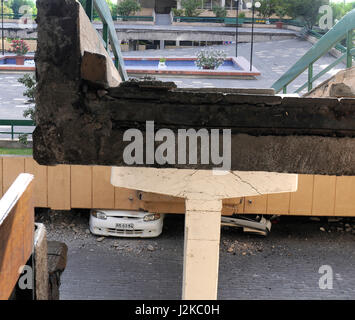 The cieling of a parking garage in a Santiago neighborhood collapsed during 8.8-magnitude earthquake on Feb. 27, - Stock Photo