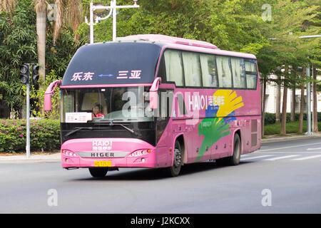 Sanya, China April 23, 2017 - Tourist bus brand Higer on the asphalt road of Hainan Island - Stock Photo