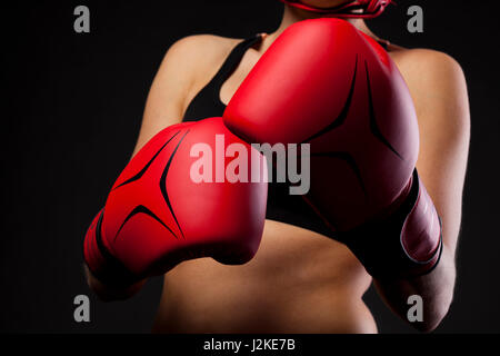 female boxer warming up before boxing match,super woman concept - Stock Photo
