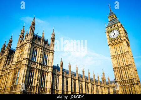 Bright scenic view of Big Ben and the Houses of Parliament at Westminster Palace in the golden light of early morning - Stock Photo