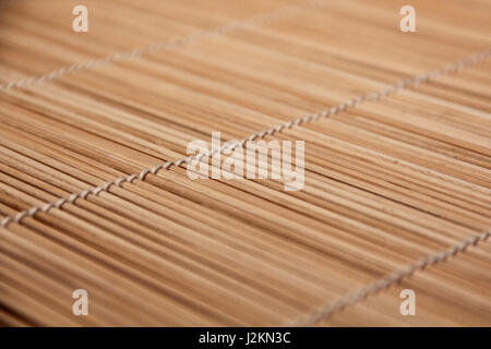 Closeup from structured tablecloth, placemats with light. Backlight with ambiente. - Stock Photo