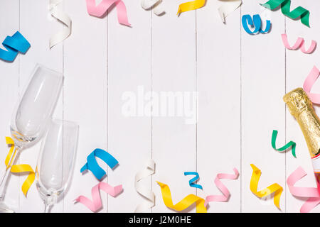 Celebration Flat lay with colorful party items on wooden background. - Stock Photo