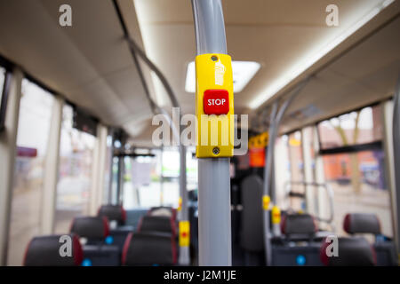 Bus stop red button on public transport UK - Stock Photo