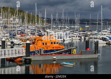 View across Brixham Harbour and Marina, with the RNLI Torbay lifeboat moored, in South Devon, UK - Stock Photo