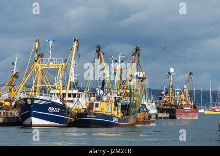 Fishing boats moored in Brixham Harbour, Devon, UK - Stock Photo
