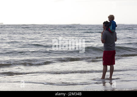 Together looking at the ocean - Stock Photo