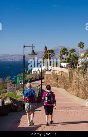Dh puerto del carmen lanzarote tourist walking passed - Lanzarote walks from puerto del carmen ...