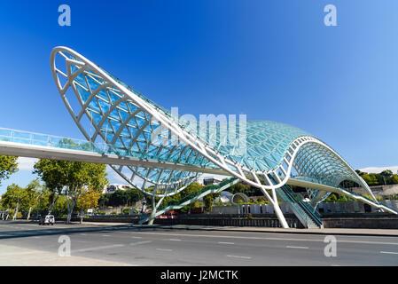 Tbilisi, Georgia - September 27, 2016: Bridge of Peace over the Kura River - Stock Photo