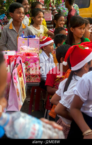 Childer are gathered for a Christmas party at a foreign language school in Chork Vilage, Tboung Khmum Province,Cambodia. - Stock Photo