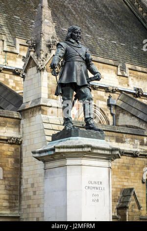Oliver Cromwell Statue outside Houses of Parliament, Palace of Westminster, London, UK - Stock Photo