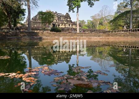 Ancient Baphuon pyramid Hindu-Buddhist stone temple of Angkor Thom, Cambodia - Stock Photo