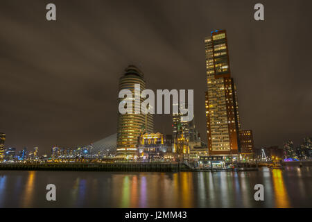 The Hotel New York and Kop Van Zuid in Rotterdam, Netherlands, seen at night from Katendrecht - Stock Photo