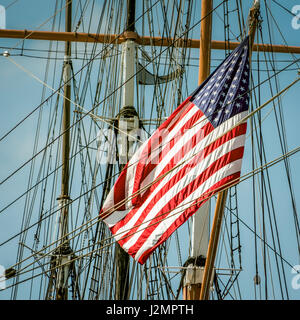 A flag on the back of a sailing ship in southern California. - Stock Photo