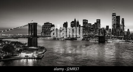 Brooklyn Bridge and Manhattan skyscrapers at twilight in Black & White. New York City - Stock Photo