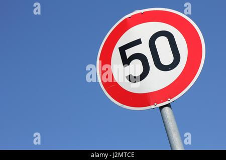 German road sign: speed limit 50 km/h - Stock Photo