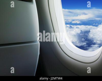 View through the airplane heavenly sky seen through the windows - Stock Photo