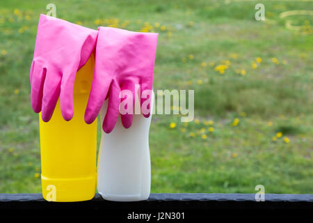 Spring cleaning concept with supplies over floral background macro