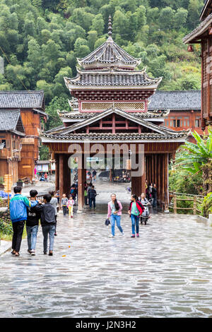 Zhaoxing, Guizhou, China, a Dong Minority Village.  Street Scene with Covered Bridge. - Stock Photo