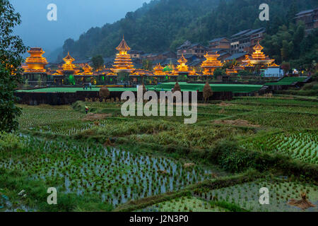 Zhaoxing, Guizhou, China, a Dong Minority Village.  In early evening buildings around the entrance to the village - Stock Photo