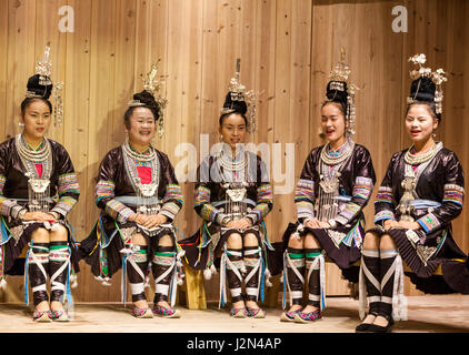 Zhaoxing, Guizhou, China.  Traditional Musical Performance by Women of the Dong Ethnic Minority. - Stock Photo
