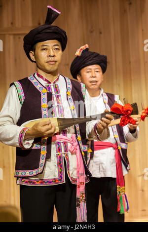 Zhaoxing, Guizhou, China.  Traditional Musical Performance by Members of Dong Ethnic Minority. - Stock Photo