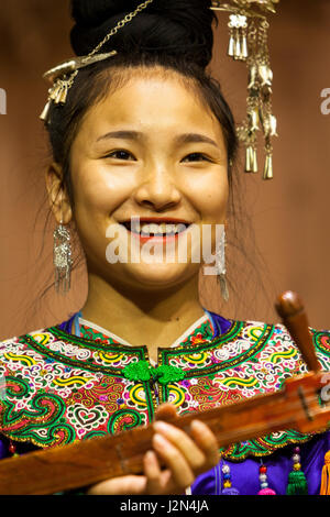 Zhaoxing, Guizhou, China.  Traditional Musical Performance by Member of Dong Ethnic Minority. - Stock Photo