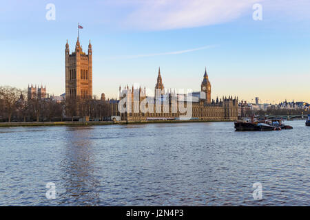View of the tower of Big Ben and parliament buildings across the Thames river in Westminster, London. Photo taken - Stock Photo