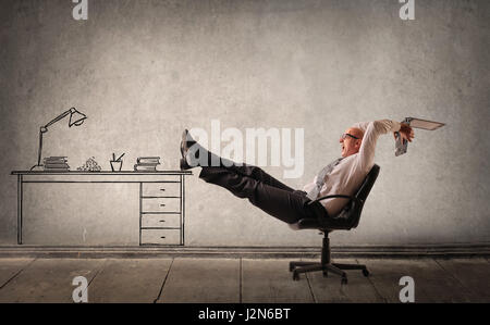 Bald businessman relaxing in office - Stock Photo
