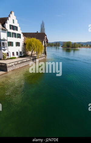 View of river in Stein am Rhein, Switzerland in a sunny clear blue sky day - Stock Photo
