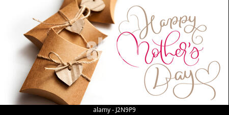 Beautiful boxes for gifts on a white background and text Happy mothers day. Calligraphy lettering hand draw - Stock Photo