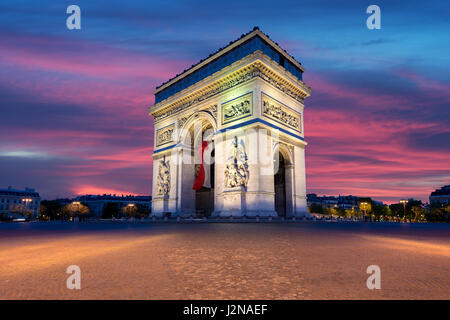 Arc de Triomphe and Champs Elysees, Landmarks in center of Paris, at sunset. Paris, France - Stock Photo