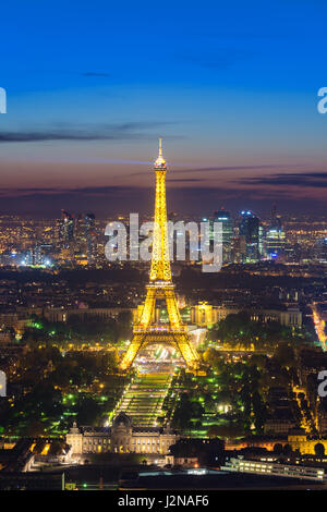 Beautiful view Eiffel tower during light show at dusk, Paris, France - Stock Photo
