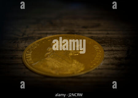 Close-up view in perspective of Austria-Hungary thaler, avers of golden coin-ducat from 1915 with Kaiser Franz Joseph - Stock Photo