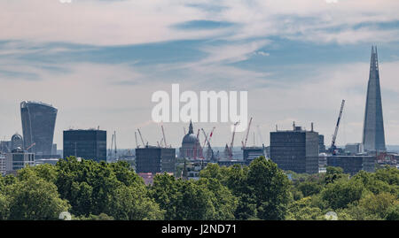 Construction cranes in the London skyline as seen from Primrose Hill - Stock Photo